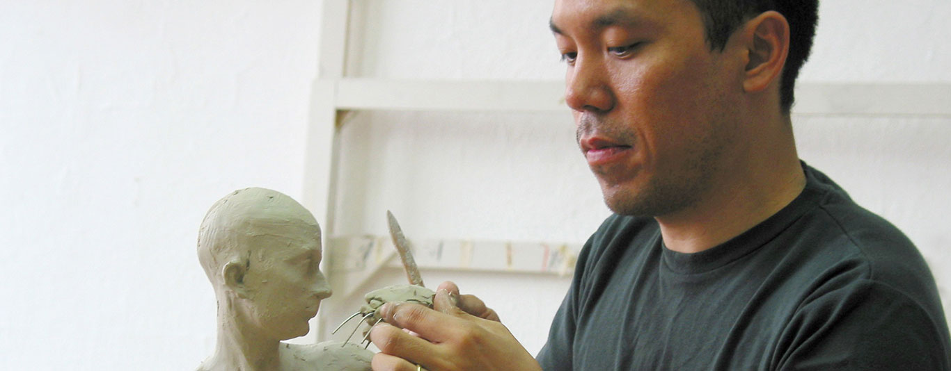 Sculpting a figure in clay
