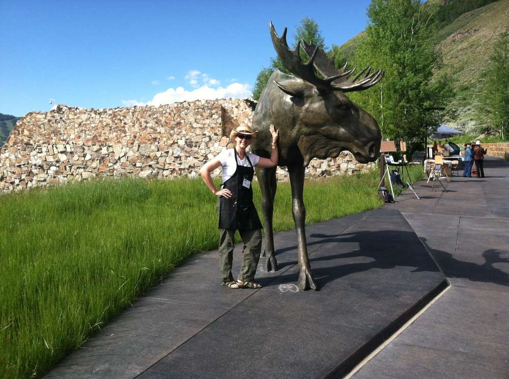 Tracy standing next to a moose sculpture