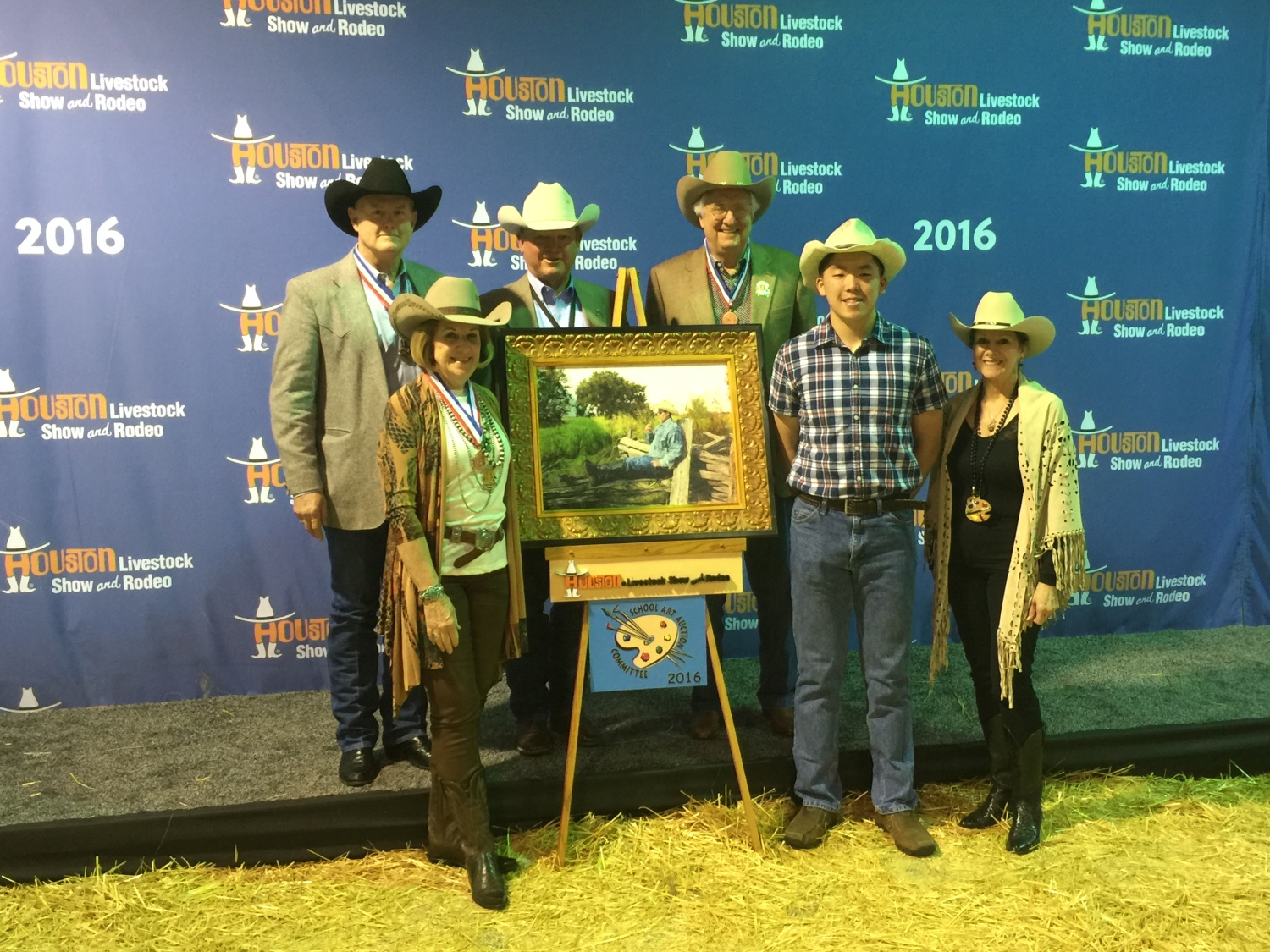 """The oil painting """" Southern Comfort"""" was sold for $25,000 at  Houston Livestock Show and Rodeo School Art Program 2016.  Anton pictured with buyers."""