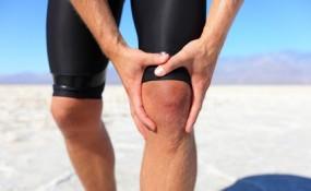 Injuries - sports running knee injury on man