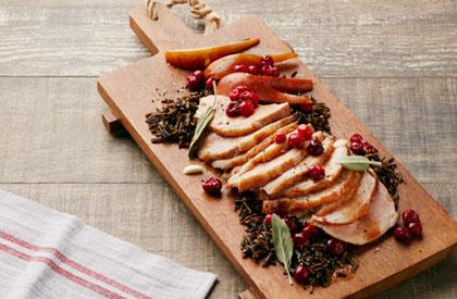 Photo de la recette de Rôti de longe aux poires et aux canneberges