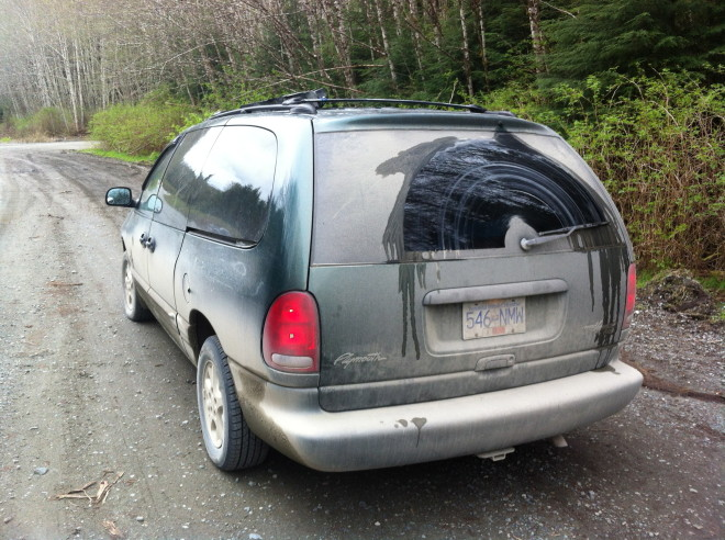 Dirty van after driving on the logging roads
