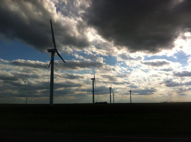 A windfarm against the setting sky