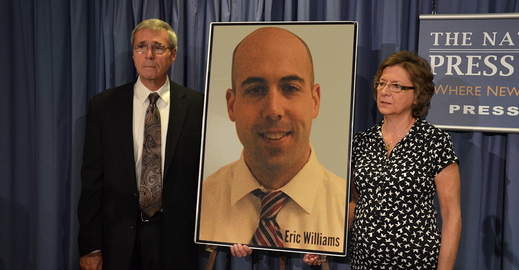 The bill was named after Correctional Officer Eric Williams. In this photo, his parents hold a photo of him at an AFGE Press Conference on the bill named after their son, in 2013.