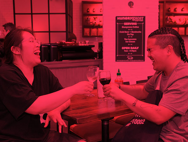 Two BAM Members clink wine glasses at a Member Mingle event