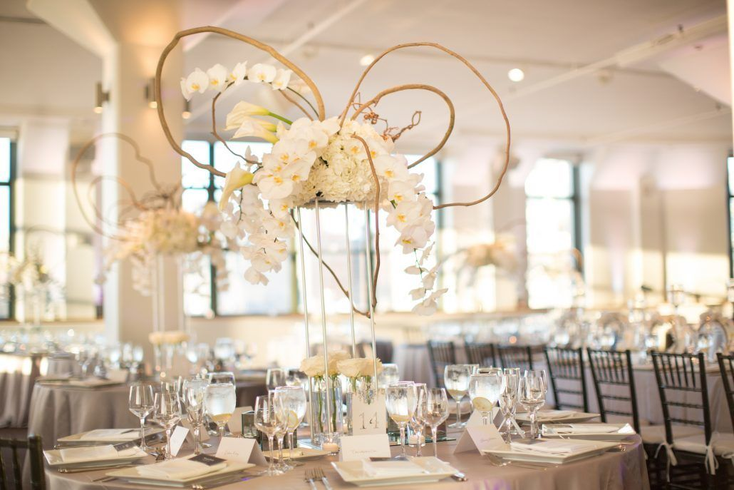 Sophia & Sam Wedding - High Centerpiece Calla Lily Hydrangea Kiwi Vine Phalaenopsis Orchid Garden Spray Rose Wisteria - Tribeca 360 NYC - by Shira Weinberger