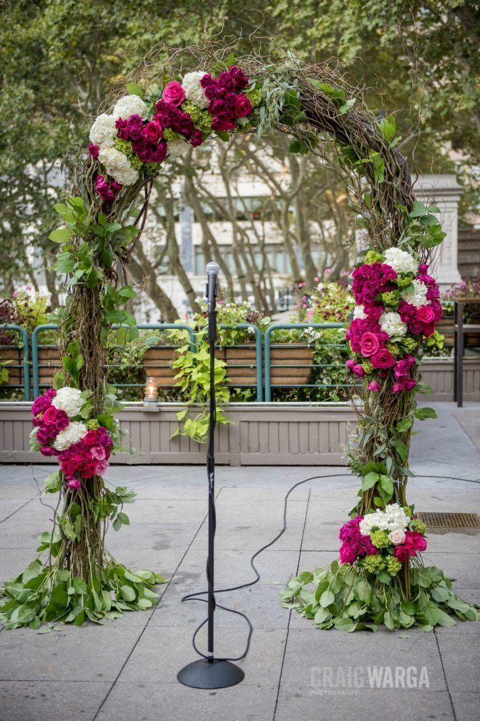 Floral Arch with Lush Greens, Hot Pink and Fuchsia Roses - Shelby and Jonathan NYC Wedding - Bryant Park Grill - Photo by Craig Warga Photography