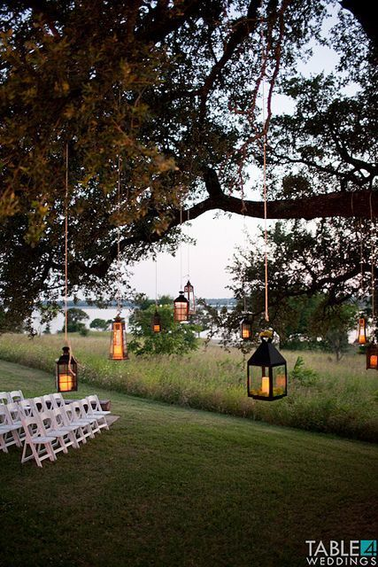 Outdoor spring wedding ideas trends by bride blossom nycs hanging lanterns outdoor ceremony space oak tree ceremony via pinterest junglespirit Images