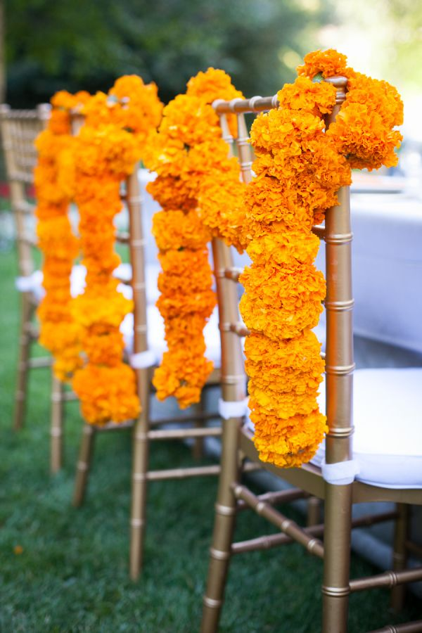 Indian Summer Outdoor Wedding - Marigold Chair Garland - via Style My Pretty - The Vault