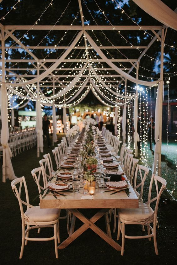 Outdoor spring wedding ideas trends by bride blossom nycs outdoor wedding hanging fairy lights lazaro and a festoon light reception photo by james frost photography via rock my wedding aloadofball Image collections
