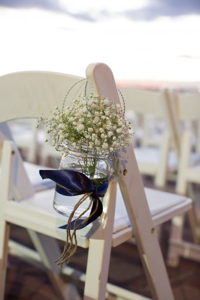For Outdoor Ceremonies, Adorn The White Chairs That Line The Aisle With  Gorgeous Floral Accents. During Indoor Ceremonies, Illuminate The Aisle  With Pillar ...