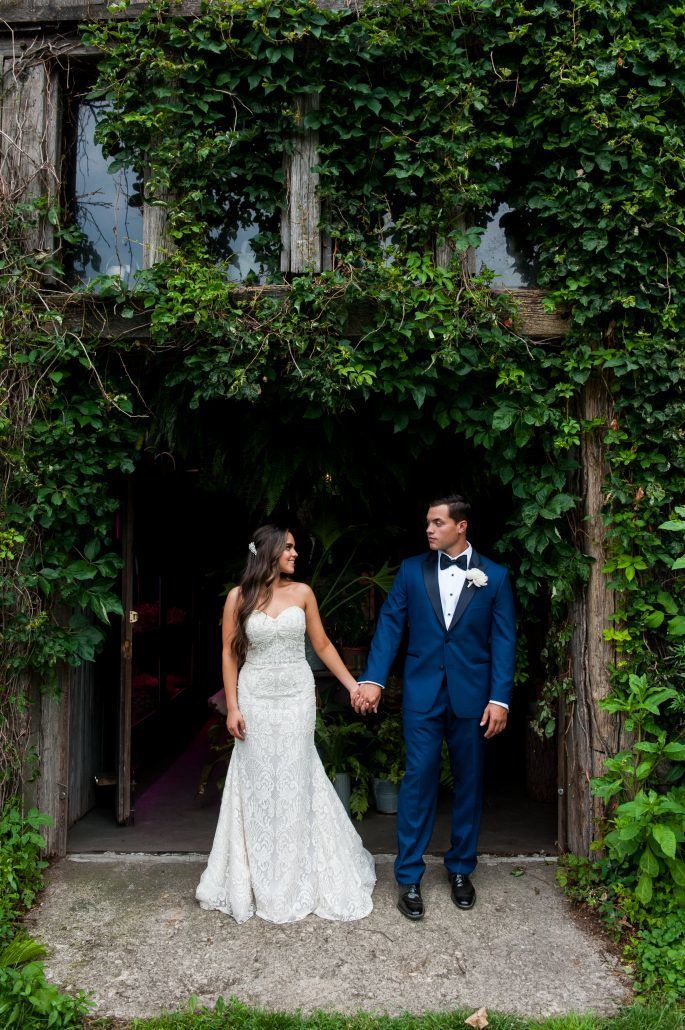 Lauren and Jordan Wedding - Bride and Groom Holding Hands - Blue Hill at Stone Barns NY - Photography by Craig Paulson