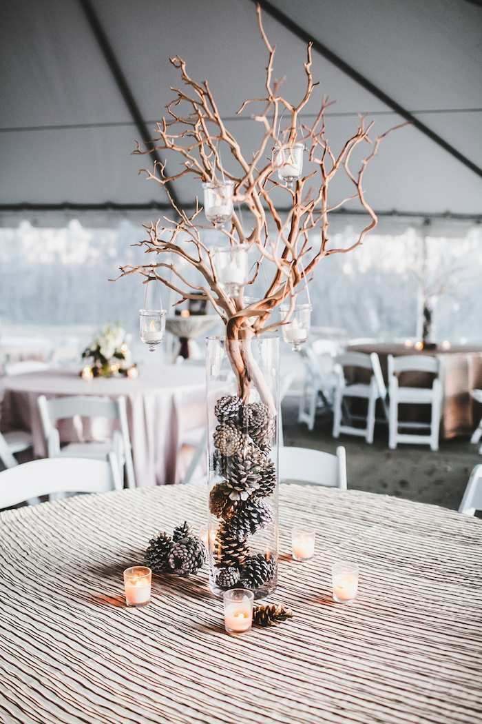 Fall wedding ideas we are loving right now by bride blossom pine cone and branch centerpiece via modwedding junglespirit Choice Image