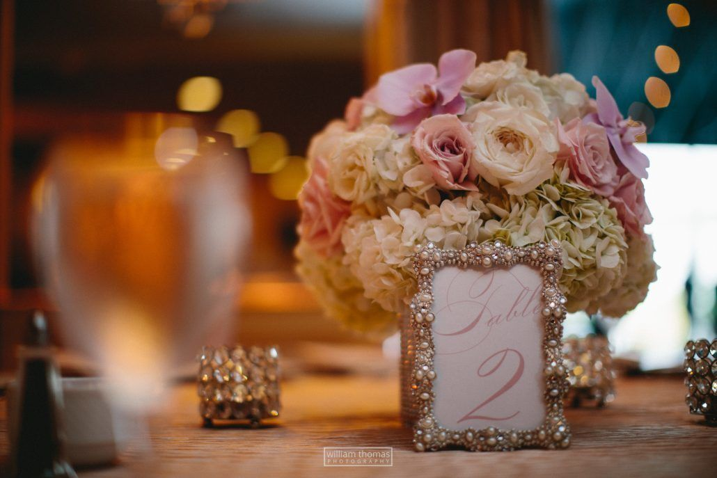 Dahiana & Christopher Wedding - Low Centerpiece with Table Number - Mansion Timber Point - by William Thomas Photography