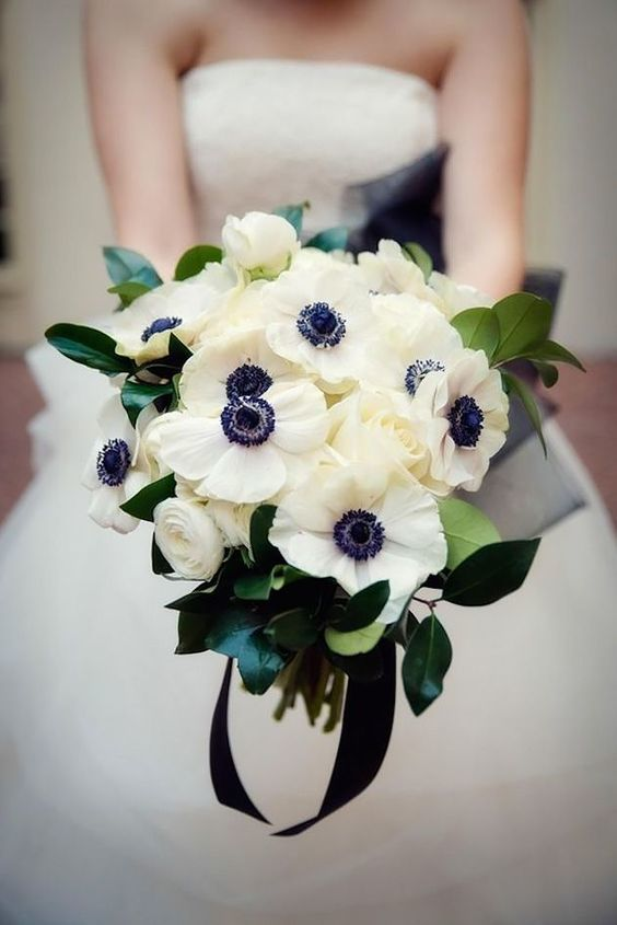 Anemone - Winter Wedding Bouquet - via weddingforward.com