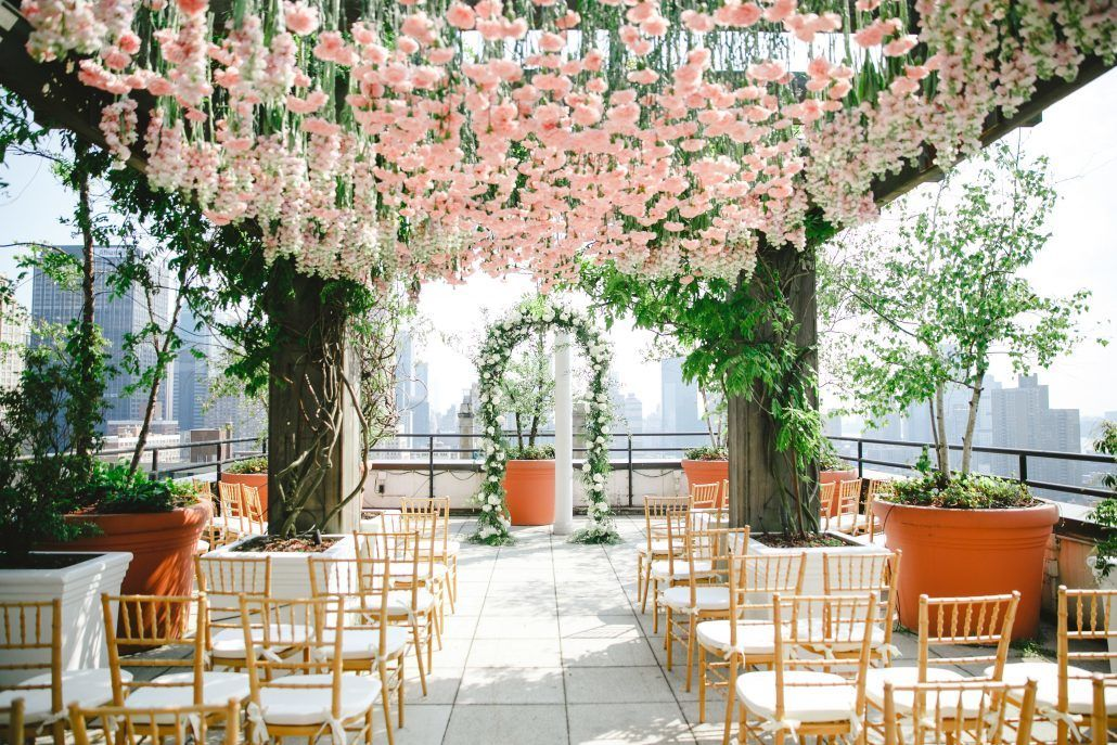Mary & Galen Wedding - Hanging pink carnations and Ceremony Arch - The Hudson Hotel NYC - Photography by Jacqueline Pierson Weddings