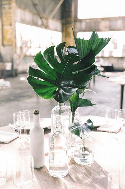 Tropical Palm Leaves Centerpiece - via mywedding.com