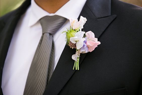 Sweet Pea Boutonniere - via weddingwire.com