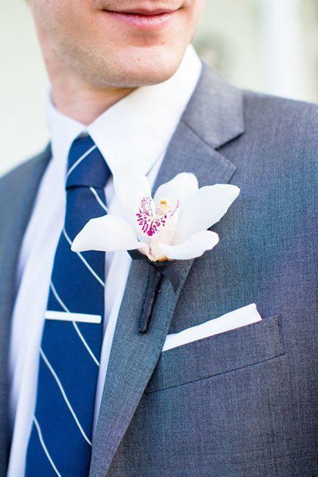 cymbidium orchid boutonniere - via brides.com