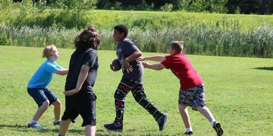 Playing football at camp!