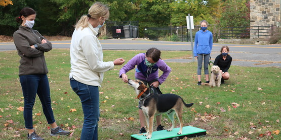 Fran Hellman of Four Paws Guidance Dog Training leads a dog obedience for youth session outside our building.