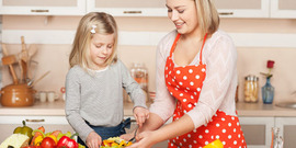 Adult cooking with child