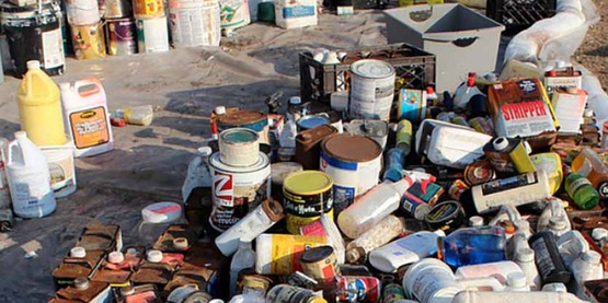 EPA collection of 'Household Hazardous Waste': collected containers and liquids are categorized and separated for proper disposal.