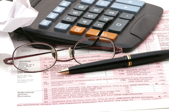 tax return, eye glasses, calculator