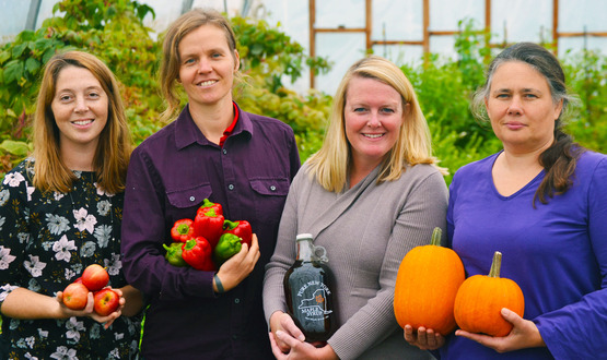 """In the photo (from left to right): Makenzie Farmer, Local Food Marketing Coordinator; Maria """"Flip"""" Filippe, Local Foods Program Leader; Brooke Rouse, Executive Director of the St. Lawrence County Chamber of Commerce; Carlene Doane, Associate Director of GardenShare."""