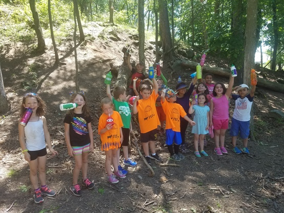 Kids in the woods at Farm Day Camp