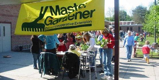 Master Gardener volunteers check out buyers at the 2008 Spring Garden Fair & Plant Sale.