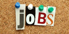 "the word ""jobs"" spelled with push-pins and cut out letters on a cork bulletin board"