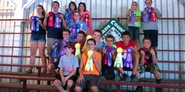 Rabbit Raisers with their ribbons at the 4-H Fair, 2016