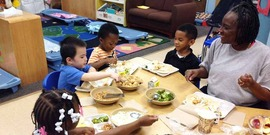Children practice family style dining and healthy eating habits at the University Head Start in St. Paul, MN. University Head Start is part of the Community Action Partnership of Ramsey and Washington Counties. Heart Start programs participate in CACFP and serve family style meals and snacks.
