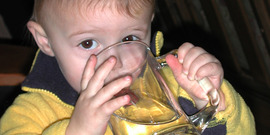 young boy drinking water from a glass. Used with permission of the father, Bill Foster.