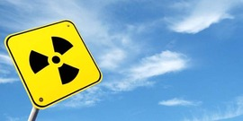 Radioactivity sign against a blue sky, for use on Radon education events