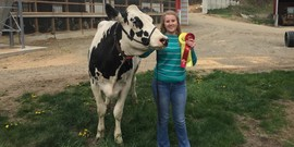 Emily ooms with her cow