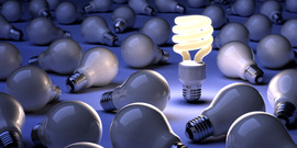 CFL lightbulb surrounded by incandescent bulbs (NOTE: this is used by CCE-Tompkins as the image for $ave Energy, Save Dollars workshops)