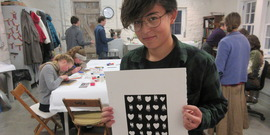 A 4-H student shows off her painting