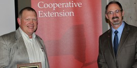 Artie Frego accepting Friend of Extension Award with Patrick Ames, Executive Director