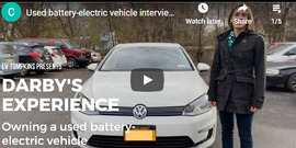 """Young woman standing next to an electric vehicle, text: """"Darby's Experience owning a used battry-electric vehicle"""""""