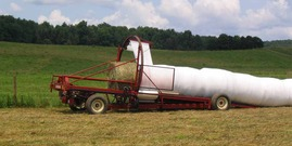 Round bales being covered in agricultural plastic; Cornell Recycling Ag Plastics Project (RAPP)