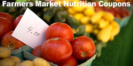 basket of tomatoes and other vegetables at a market, overlaid with the text  Farmers Market Nutrition Coupons