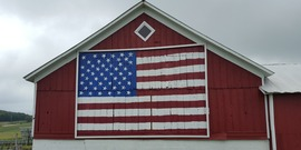 barn with flag