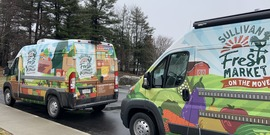Sullivan Fresh Community Cupboard vans parked