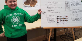 A 4-H member with her presentation board.