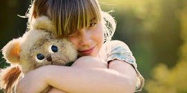 girl holding a stuffed toy