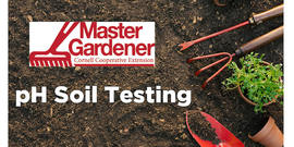Picture of soil with gardening tools
