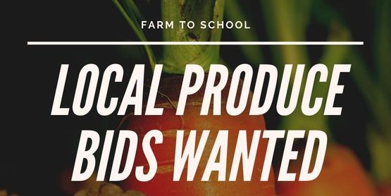 """LOCAL PRODUCE BIDS WANTED"" in text with a background of carrots in a field"
