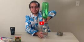boy holding plastic bottle